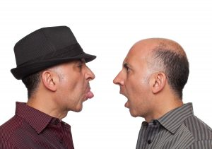 men-sticking-tongues-at-each-other-300x211
