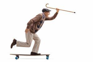 Man-w-cane-skateboard-4839-3249-0399-v1-300x200