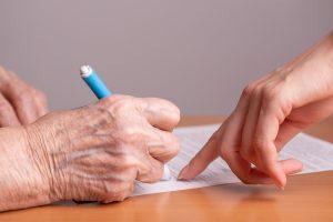 elderly-signing-300x200